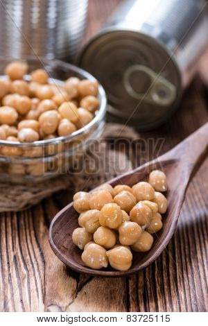 Portion of Chick Peas (Canned) on old wooden background poster