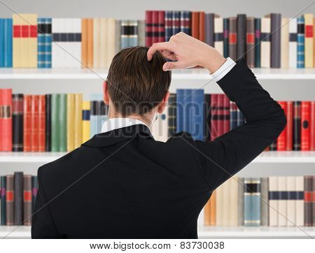 Man In A Suit Scratching His Head