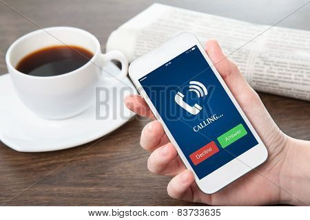 Businesswoman Hand Holding A Phone Blue Screen And The Phone Ringing Tube In The Office