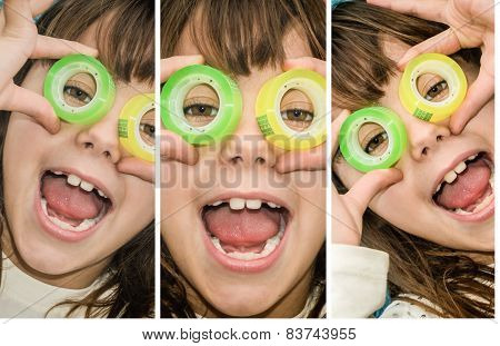 Beautiful Little Girl Is Looking Through The Circles Of A Scotch Tape