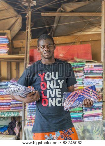 Vendor in front of his fabric store, Sandaga Market