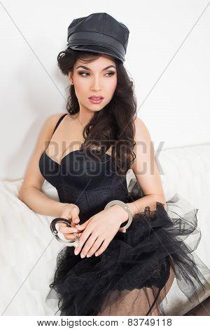 beautiful  brunette semi nude with handcuffs