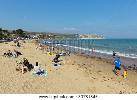 The beach in summer Swanage on the Dorset coast visitors to enjoy this popular town