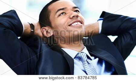 Portrait of a relaxed businessman looking away