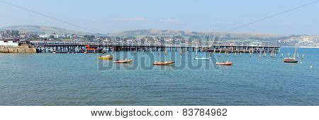 Swanage pier and jetty Dorset England UK with sea and coast on a beautiful summer day panorama