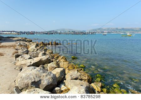 Swanage harbour pier and jetty Dorset England UK with sea and coast on a beautiful summer day