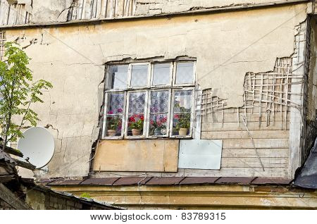 Old Rural House Window With Flowers And Satelite Dish