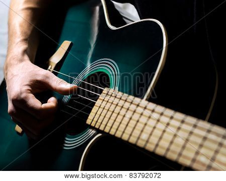 A Man Musician Playing On The Guitar
