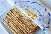 Traditional Jewish Matzo sheet on a Passover Seder table. Passover is a predominantly Jewish holy day and festival. It commemorates the story of the Exodus in which the ancient Israelites were freed from slavery in Egypt. poster