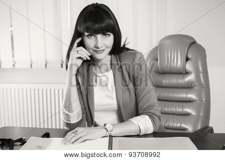 Black and white.Woman in a business suit.