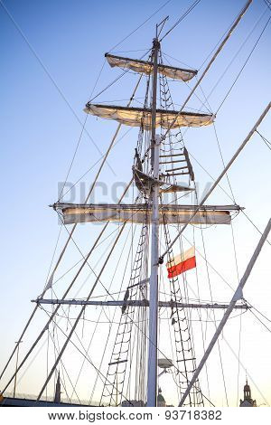 Mast Of A Sailing Ship Moored In Szczecin At Sunset.