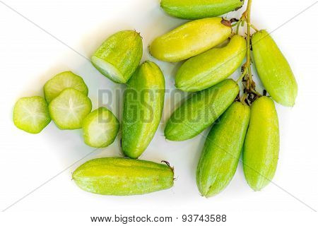 Very sour bright green Kamias fruit popular in Southeast Asia clinging to the trunk of a tropical cucumber tree. poster