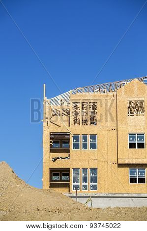 Big multifamily housing under construction against blue sky poster
