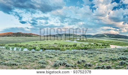 dusk over North Platte River in Colorado North park above Northgate Canyon, early summer scenery - panorama