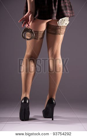 Girl In Stockings With Dollars And Handcuffs