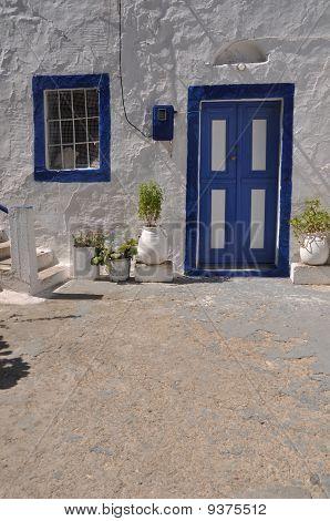 traditional blue greek door in Zia village (Kos) Greece poster