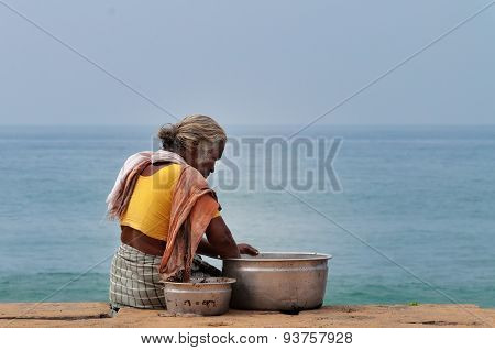 Indian Woman With Dish Fish On Samudra Beach In Kovalam