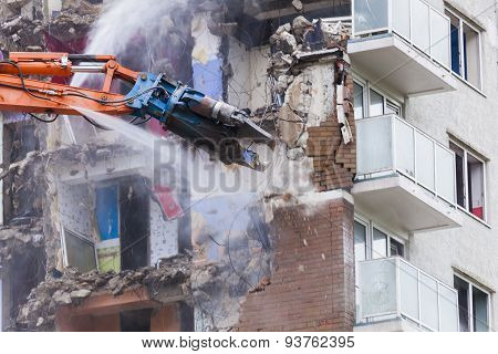 Construction work demolishing high rise flats signifying housing and regeneration poster