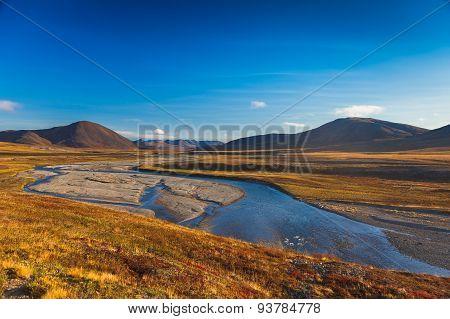 Colorful autumn tundra and river Amguema Arctic Circle, Russia