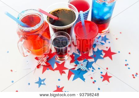 american independence day, celebration, patriotism and holidays concept - close up of cups and glasses with drinks on american independence day party from top