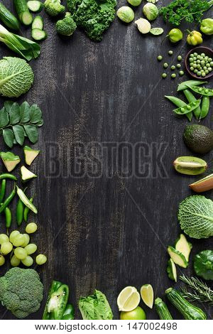 Food poster collection of fresh green vegetables on dark rustic distressed background, part of a set
