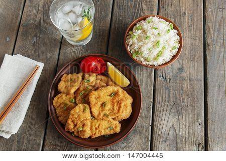 roasted schnitzel chop escalope with lemon tomato rice
