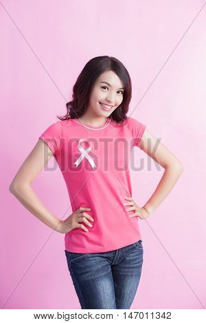 Happy Woman with pink ribbon great for prevention breast cancer concept
