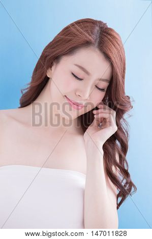 Beauty woman relax closed eye with charming smile with health skin and hair isolated on blue background asian beauty