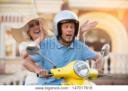 Scooter driver closed his eyes. Mature lady is laughing. You're still fooling around. Nothing really matters to me.