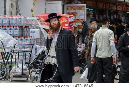 Orthodox Jewish Man With Mobile Phone Walk At Street Market In Jewish .quarter. Jerusalem. Israel