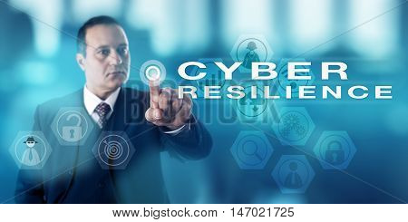Information security director with serious facial expression is activating the words CYBER RESILIENCE on an interactive control screen. Business metaphor. Concept for computer security procedures.