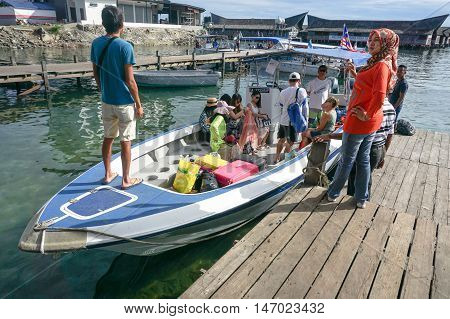 Semporna,Sabah-Sept 10,2016:Speedboat with tourists at terminal Semporna,Sabah on 10th Sept 2016.Its a gateway for diving & snorkeling trips to the islands of Sipadan,Mabul,Mataking,Maiga & others