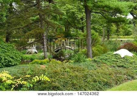 GENEVA, ILLINOIS - SEPTEMBER 9, 2016: Fabyan Japanese Tea Garden. Designed in 1910 by landscape architect Taro Otsuka as a private garden for George and Nelle Fabyan.
