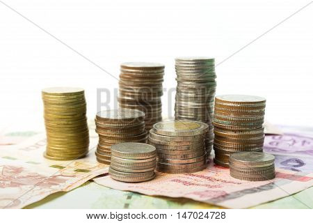 Baht coins and banknote money on w้ระำ background
