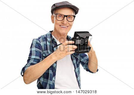 Elderly hipster holding a polaroid camera isolated on white background