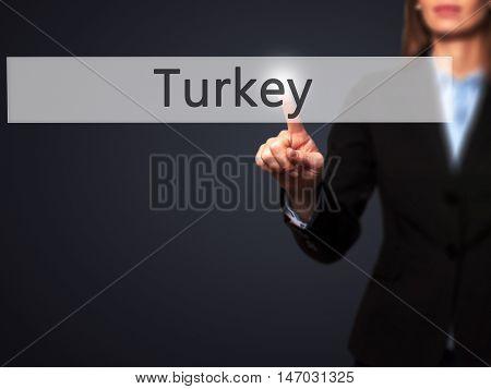 Turkey - Businesswoman Pressing High Tech  Modern Button On A Virtual Background