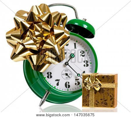 Alarm clock with gift box. Time for the holiday's concept with clock and present isolated on white background.