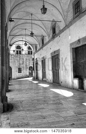 The world wide famous Logge del Vasari in the medieval city centre of Arezzo, designed in the tenth century by the famous artist Giorgio Vasari. Black and white photo.
