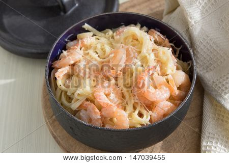 Pasta with shrimps fettucine cream cheese parmesan in frying pan