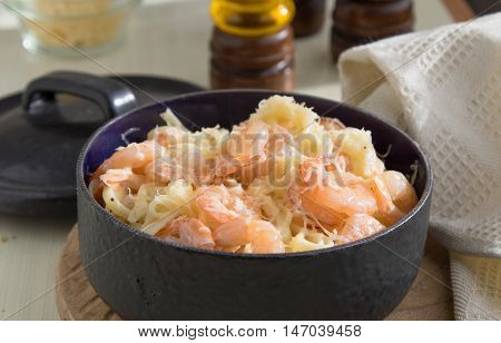 Pasta with shrimps fettucine oil cream cheese parmesan and spices in pan