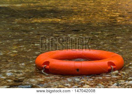 Orange swim ring for fun at the river.