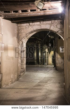 Girona (Gerona Catalunya Spain): old typical street under a portico by night
