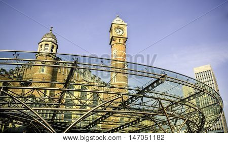 GENT (Ghent), BELGIUM - MAY 12, 2016: Looking upward through an outdoor shelter at the main entrance to Gent-Sint-Pieter Train Station. This finely-engineered shelter is made of thin strips of metal and a clear material, which allows light in and also giv