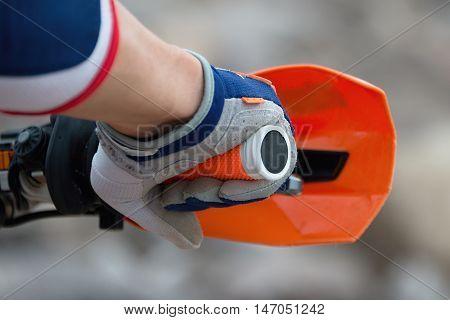 Hand rider on handlebars sports motocross racing
