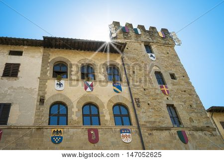 Typical facade of an medieval palace in Arezzo (Italy, Tuscany), decorated with the signs of the city districts used during the medieval historical reenactment known as Giostra del Saracino. Color image.