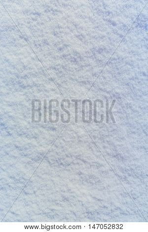 Background of fresh powder snow texture in blue tone