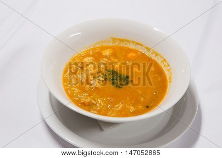 Spicy Thai soup Tom Yam with Coconut milk Chili pepper and Seafood