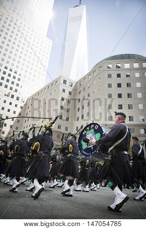 NEW YORK - SEPT 9 2016: Members of the NYPD Emerald Society Pipe and Drums lead the 9/11 Memorial Procession and Commemoration Service on the 15th anniversary of the terror attacks.