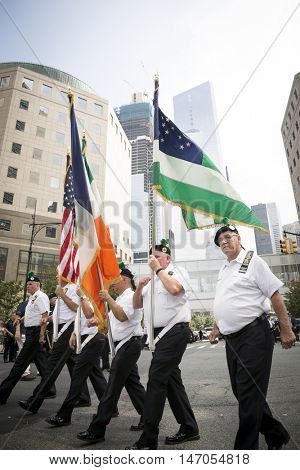 NEW YORK - SEPT 9 2016: Honor Guard from the NYPD Emerald Society Pipe and Drums present colors in front of the 9/11 Memorial Procession on the 15th anniversary of the terror attacks.