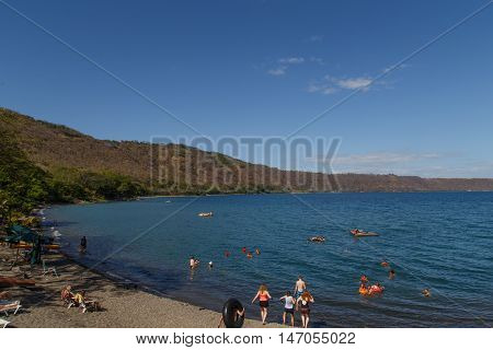 Masaya Nicaragua on March 12 2016 Apoyo Lagoon view with people on recreation in sunny day on summer.